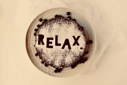 Relax written in coco powder on top of a hot drink