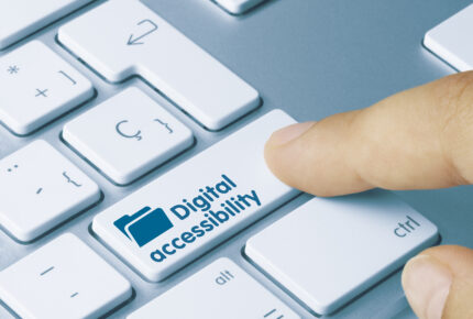 Person pressing key on keyboard